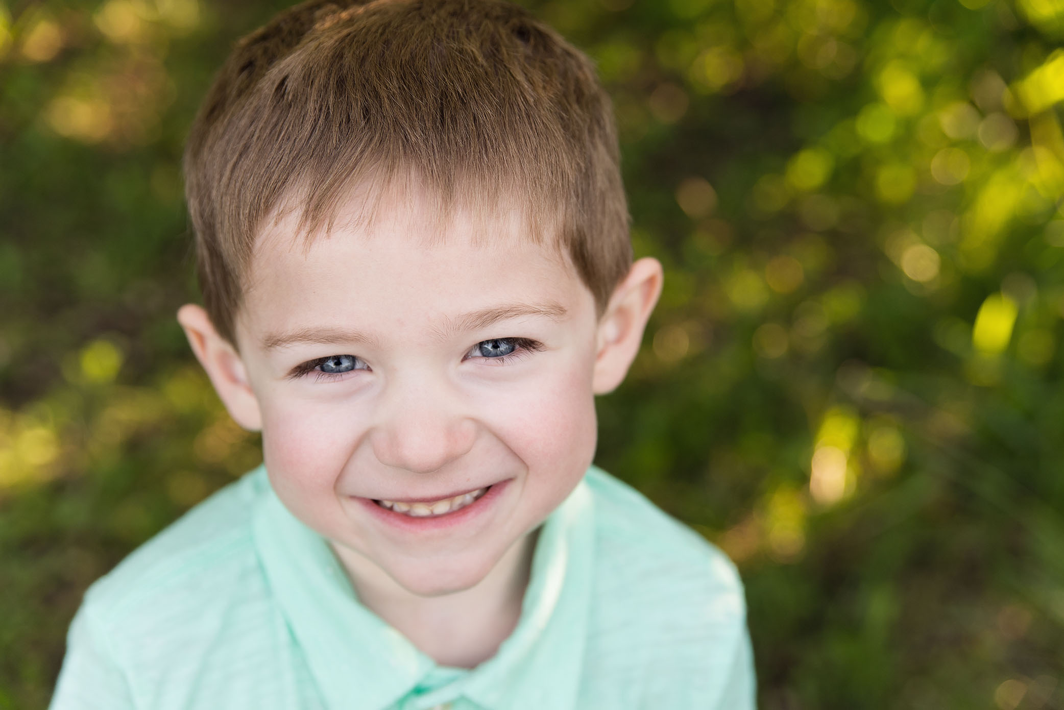 A cute, adorable boy smiles in Cedar Rapids for his photography session