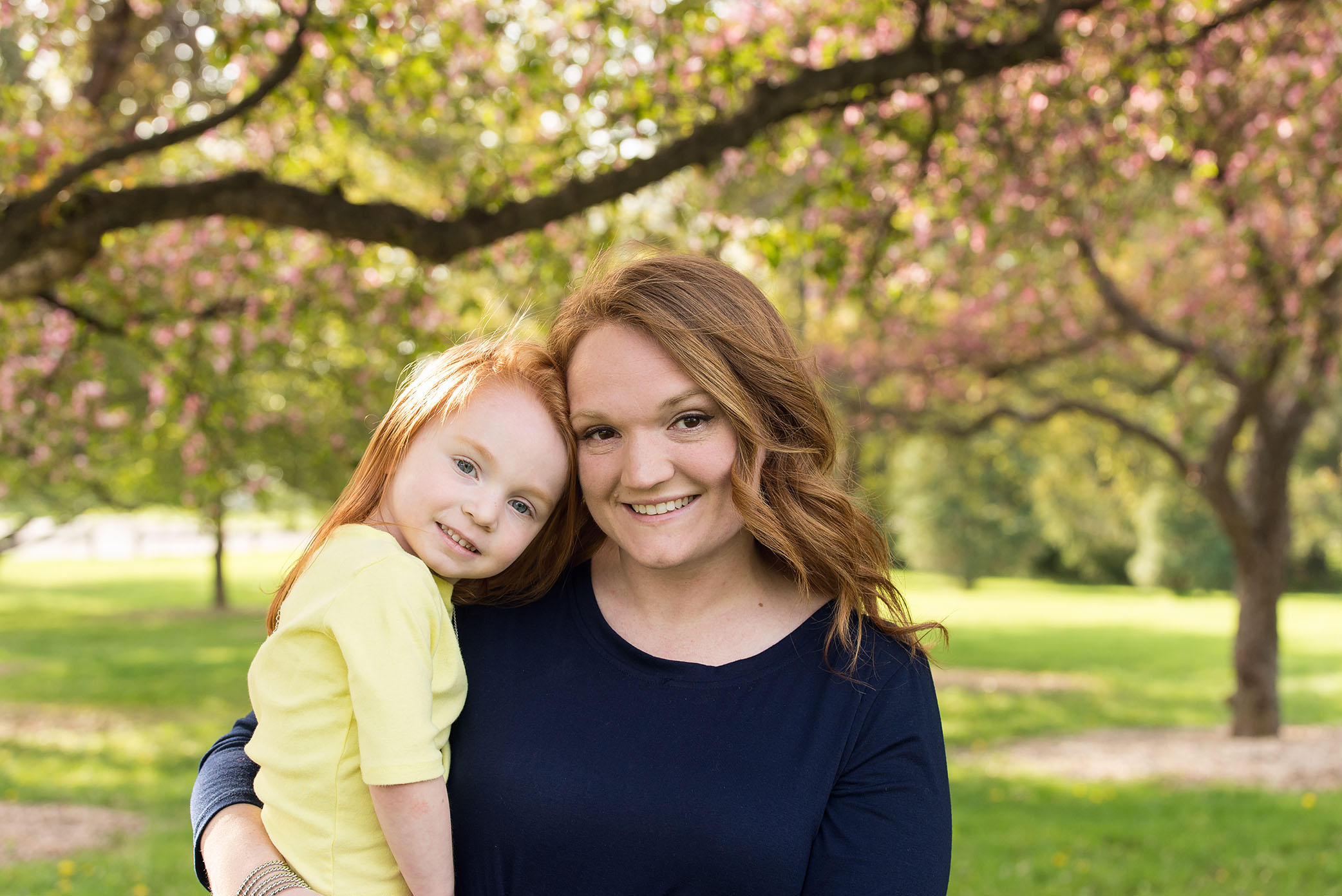 A mom and daughter play in a park in Cedar Rapids