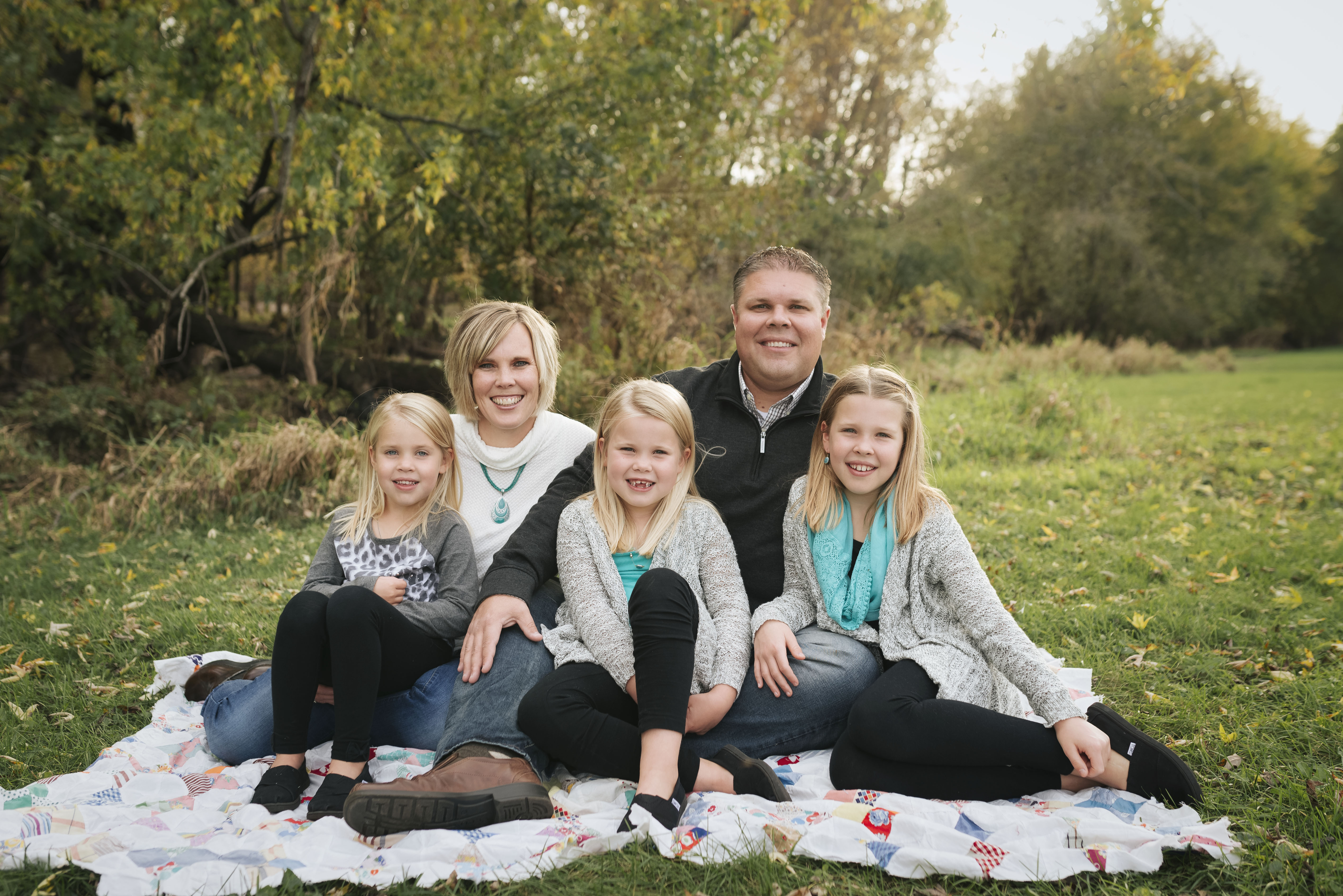 a family smiles in cedar rapids during their photography session