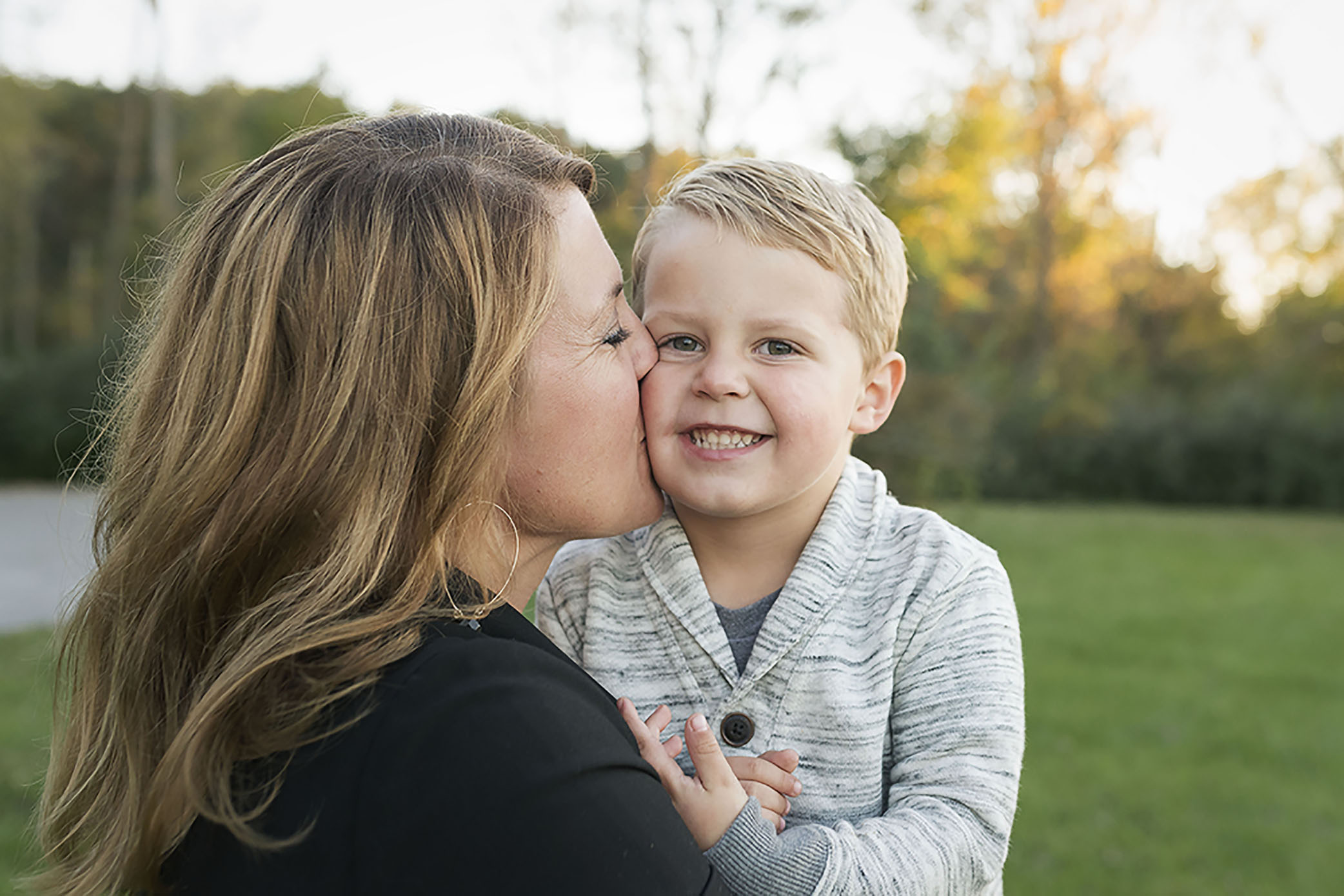 mom kisses her baby boy in Cedar Rapids
