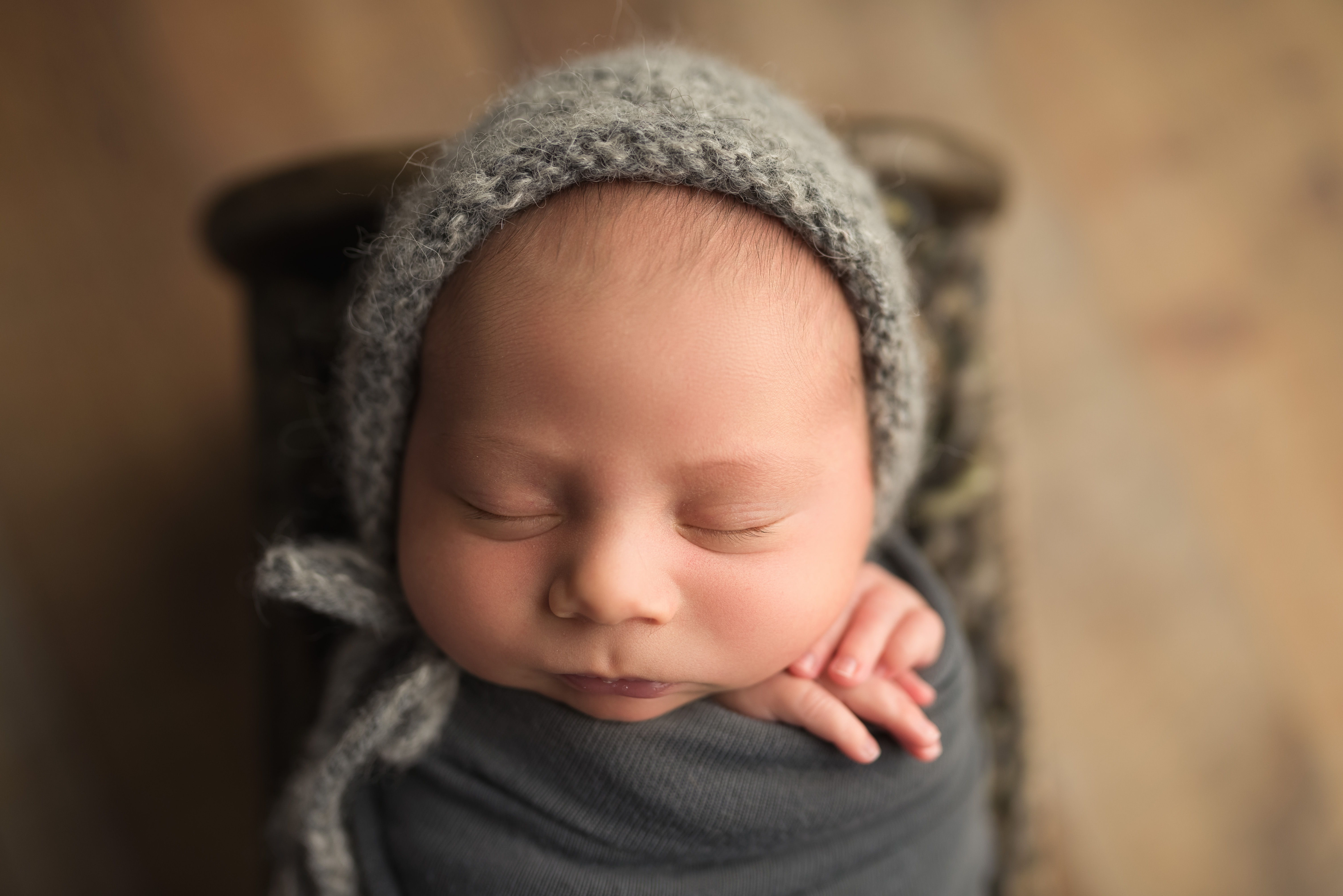 a newborn boy sleeps during  his photography session in Cedar Rapids