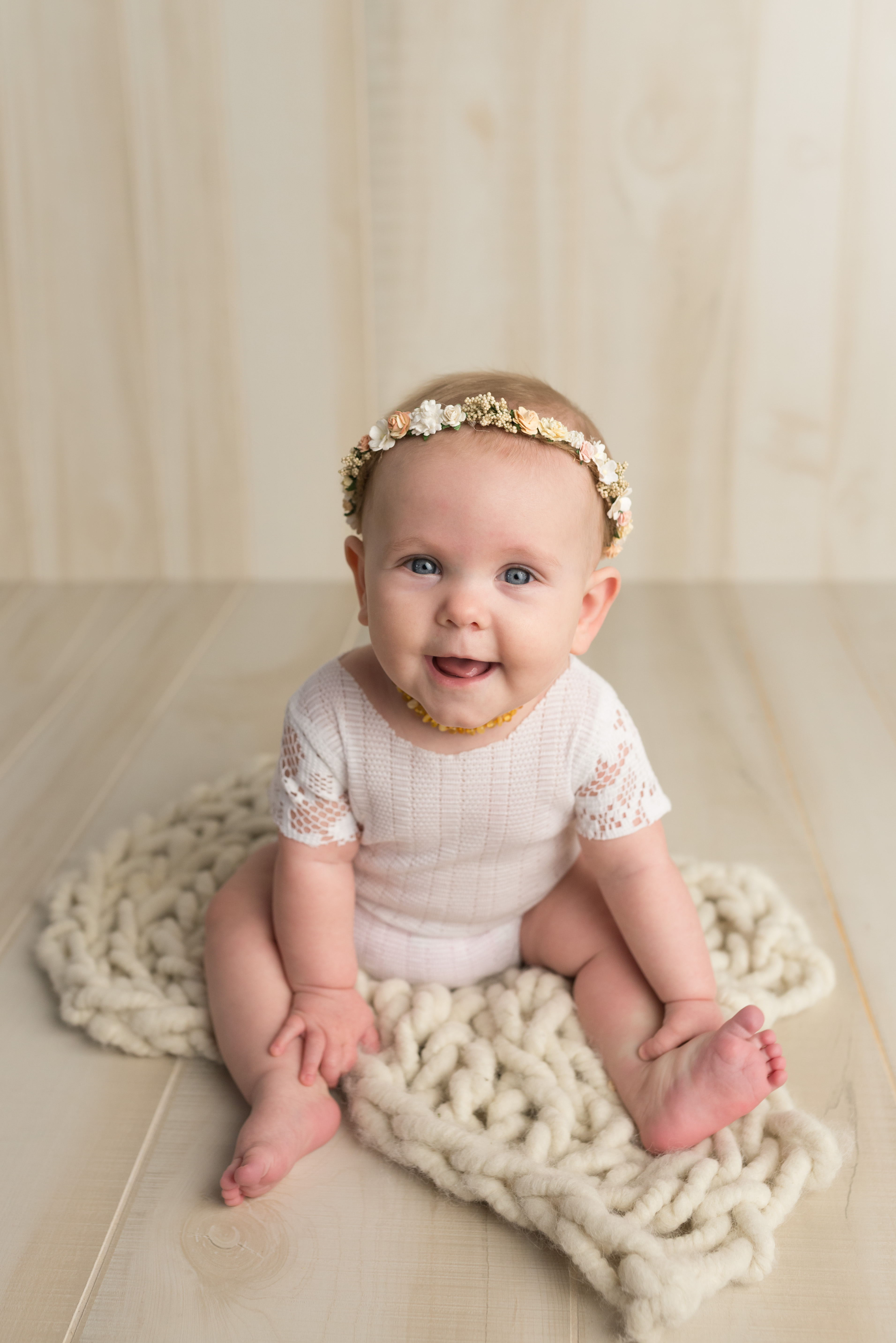cutest 6 month old baby in Cedar Rapids during her photography session