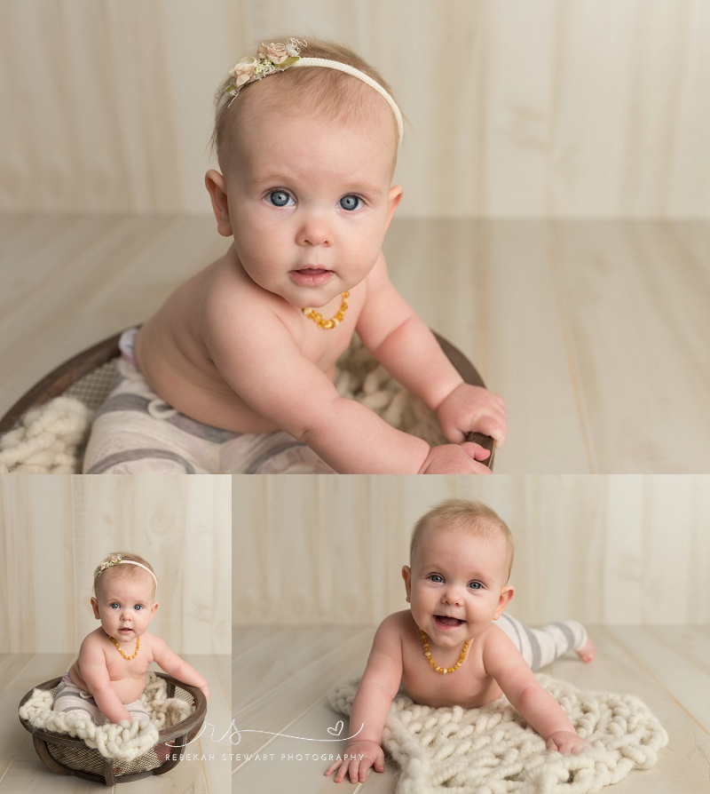 Cedar Rapids baby photography - a one year old baby smiles during her photo session