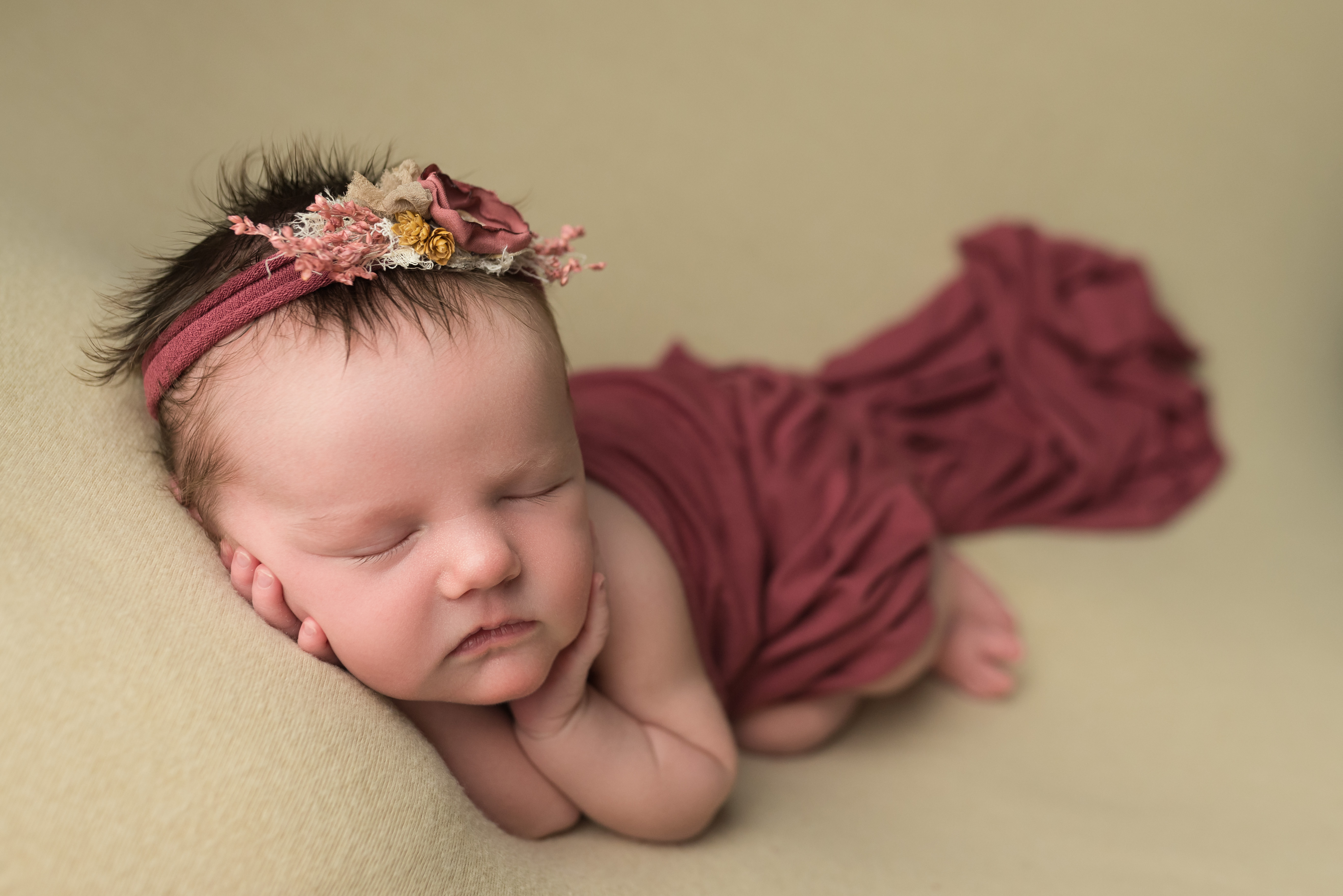 A newborn baby girl sleeps during her photography session in Cedar Rapids
