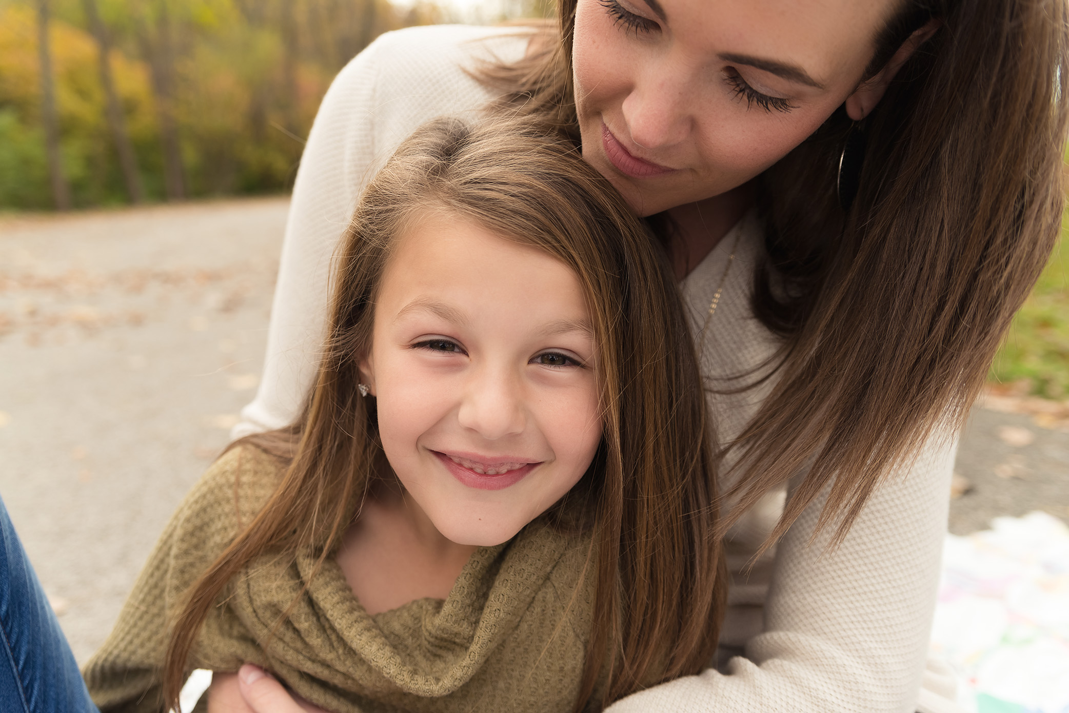 A sweet family with mom and daughter snuggles and laughs during their Cedar Rapids photography session