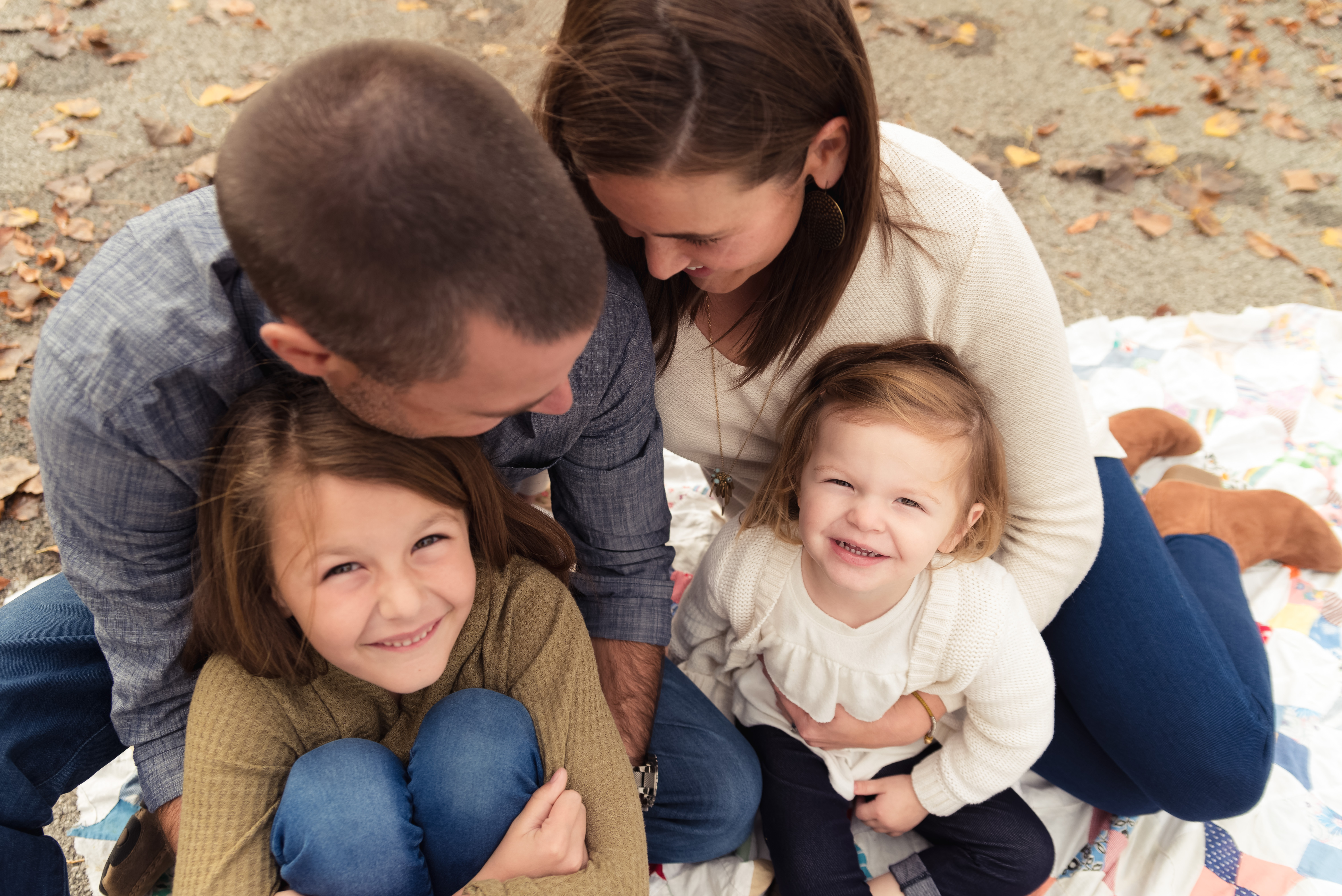 A sweet family snuggles and laughs during their Cedar Rapids photography session